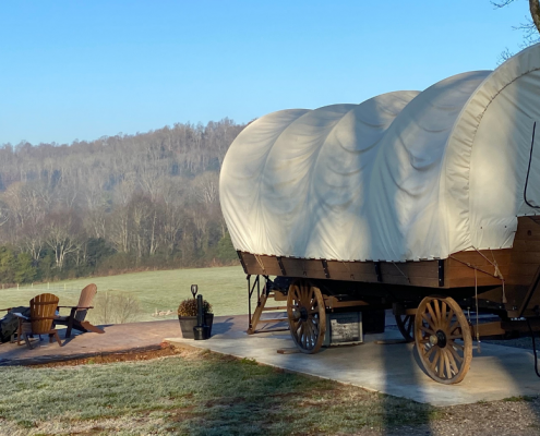 Outdoor scene with covered wagon